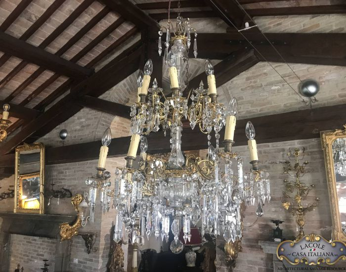 Antique chandelier made of brass and crystal glass drops