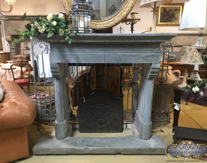 Antique stone fireplace with base